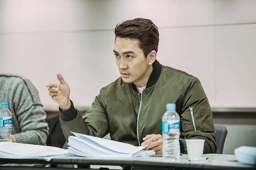 This photo, provided by BA Entertainment, shows Song Seung-heon during a rehearsal reading of the movie script. (Yonhap)