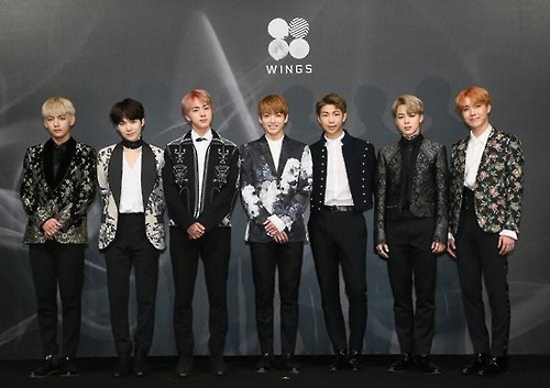 "Members of Bangtan Boys, or BTS, pose for photos at a press event in Seoul on Oct. 10, 2016, on the release of their second album ""Wings."" (Yonhap)"