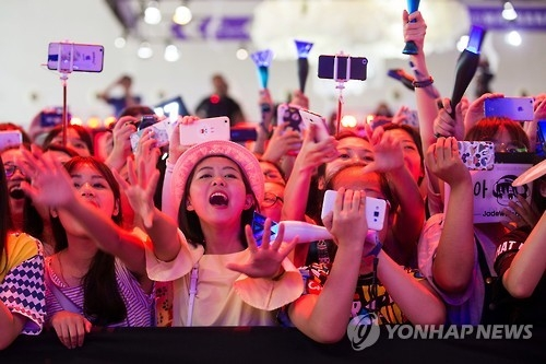 In this Associated Press photo taken on July 22, 2016, Chinese fans cheer during a concert by the South Korean K-Pop group Winner in Shanghai. (Yonhap)