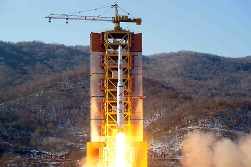 This undated file photo shows a long-range missile about to be fired from a launcher in North Korea. (For Use Only in the Republic of Korea. No Redistribution) (Yonhap)