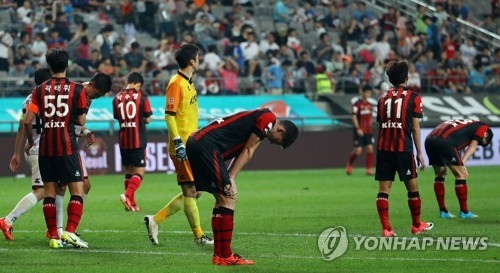 In this file photo taken on June 25, 2017, the players of FC Seoul react after losing to Sangju Sangmu 2-1 in their K League Classic match at Seoul World Cup Stadium in Seoul. (Yonhap)