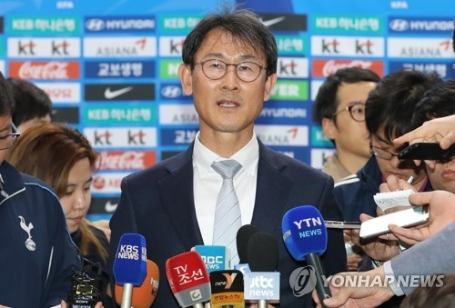In this file photo taken on April 13, 2017, South Korea women's football head coach Yoon Duk-yeo speaks to reporters at Gimpo International Airport in Seoul. (Yonhap)