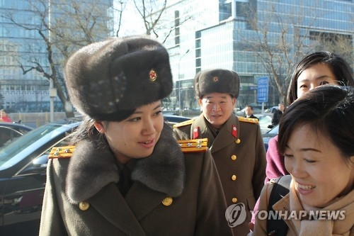 In this file photo, Hyon Song-wol (L), leader of North Korea's all-female Moranbong Band, is seen arriving at a hotel in Beijing on Dec. 11, 2015. (Yonhap)