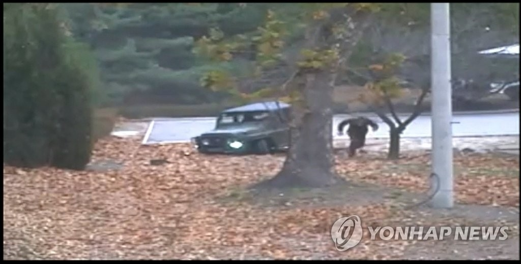 A North Korean soldier runs toward South Korea after exiting a jeep at the truce village of Panmunjom in a video clip released by the United Nations Command on Nov. 22, 2017. (Yonhap)