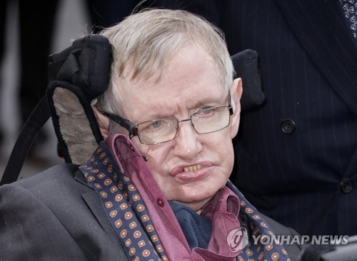 This file photo, taken on March 30, 2015, by the Associated Press shows British scientist Stephen Hawking at the Interstellar Live show at the Royal Albert Hall in central London. (Yonhap)