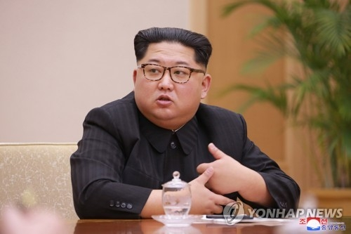 This photo, carried by North Korea's state news agency on April 10, 2018, shows North Korean leader Kim Jong-un presiding over a meeting of the Political Bureau of the Central Committee of the ruling Workers' Party of Korea (WPK) a day earlier. (For Use Only in the Republic of Korea. No Redistribution) (Yonhap)
