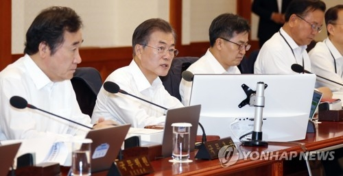 President Moon Jae-in (second from L) speaks in a Cabinet meeting held at his office Cheong Wa Dae in Seoul on July 3, 2018. (Yonhap)