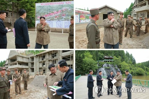 (LEAD) N.K. leader Kim inspects construction sites, farm - 1