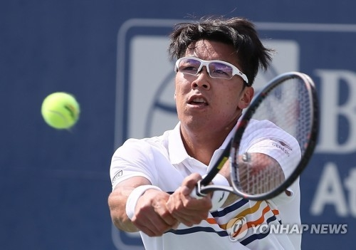 In this Getty Images file photo from July 27, 2018, Chung Hyeon of South Korea hits a return to Ryan Harrison in the quarterfinals of the BB&T Atlanta Open tennis tournament at Atlantic Station in Atlanta. (Yonhap)