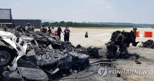This photo, provided by the family of a victim, shows the wreckage of a marine chopper at a military airport in the southeastern city of Pohang. (Yonhap)