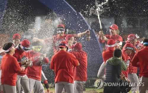 Members of the SK Wyerns spray champagne on each other after winning the 2018 Korean Series over the Doosan Bears with a 5-4 win in Game 6 at Jamsil Stadium in Seoul on Nov. 12, 2018. (Yonhap)
