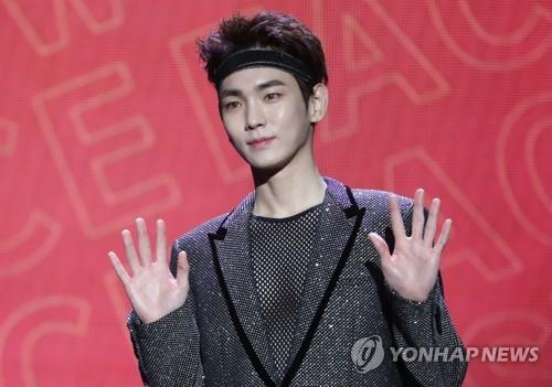 "SHINee's Key poses for photos during the showcase for his debut solo album, ""Face,"" on Nov. 26, 2018. (Yonhap)"