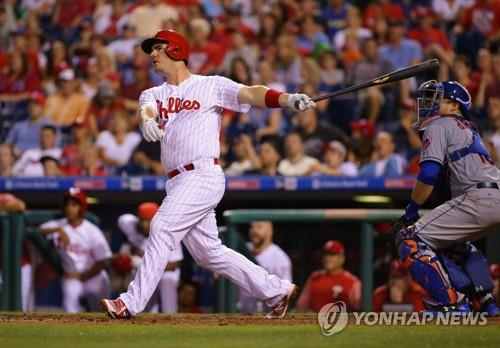 In this Getty Images file photo from Aug. 12, 2017, Tommy Joseph, then with the Philadelphia Phillies, hits a sacrifice fly against the New York Mets in the bottom of the eighth inning of a Major League Baseball regular season game at Citizens Bank Park in Philadelphia. Joseph has signed a one-year, US$1 million contract with the LG Twins in South Korea. (Yonhap)