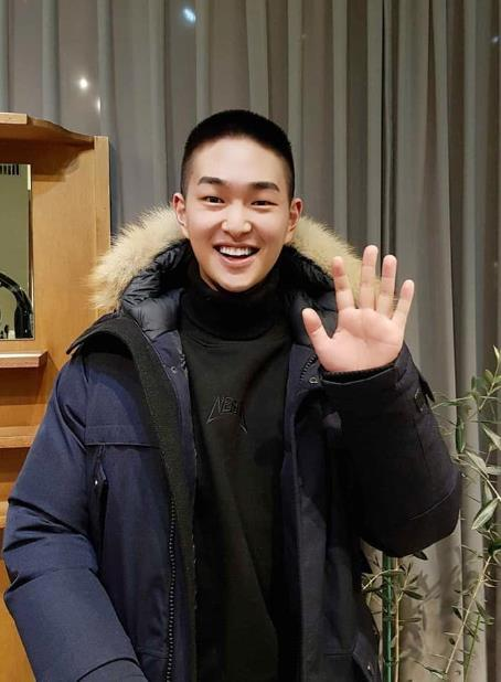 This image of Onew, boy band SHINee's member, with a short, military-style haircut, is captured from a SHINee social media account. (Yonhap)