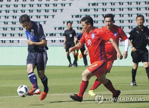 This undated file photo provided by Kyodo News shows a friendly football match between South Korean and Japanese lawmakers. (Yonhap)