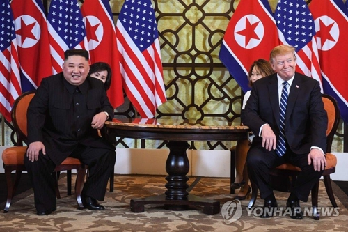 This AFP photo shows North Korean leader Kim Jong-un (L) and U.S. President Donald Trump seated together at the Sofitel Legend Metropole Hanoi hotel on Feb. 28, 2019. (Yonhap)