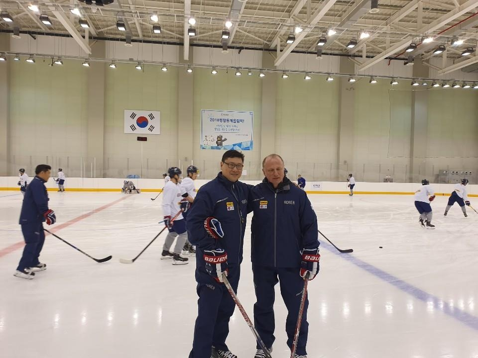 This undated photo provided by the Korea Ice Hockey Association shows Jim Paek (L), head coach of the South Korean men's national team, with his assistant Sergei Nemchinov. (Yonhap)