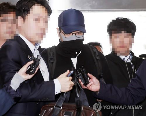 A grandson of Hyundai Group founder Chung Ju-yung enters Incheon Metropolitan Police Agency after being arrested for suspected illegal drug use at Incheon International Airport, west of Seoul, on April 21, 2019.