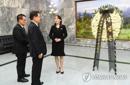 Kim Yo-jong (R), North Korean leader Kim Jong-un's sister, speaks to Chung Eui-yong (C), head of South Korea's presidential National Security Office, and Rep. Park Jie-won of the minor opposition Party for Democracy and Peace at Tongilgak, a North Korean building in the truce village of Panmunjom inside the Demilitarized Zone, on June 12, 2019, in this photo released by the unification ministry. Kim delivered to Chung and Park a condolence message and a wreath of flowers that the North Korean leader sent to the funeral of Lee Hee-ho, the widow of former President Kim Dae-jung who died on June 10 at age 96. (PHOTO NOT FOR SALE) (Yonhap)
