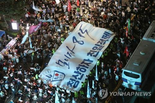 This file photo taken Aug. 10, 2019, shows an anti-Japanese candlelight vigil in central Seoul. (Yonhap)
