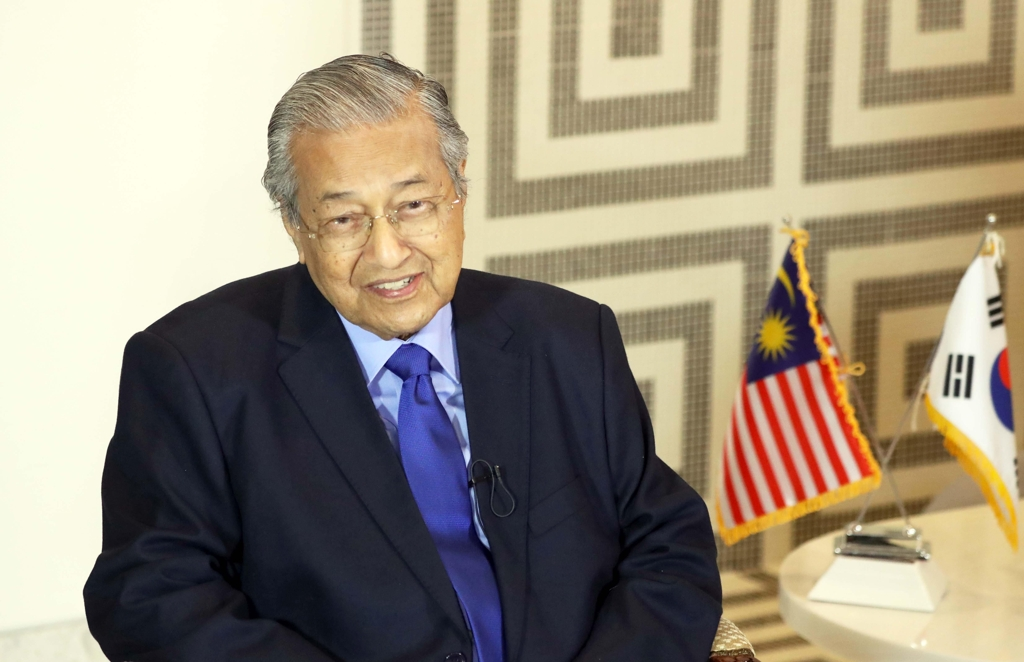 Malaysian Prime Minister Mahathir Mohamad speaks during an interview with Yonhap News Agency at his hotel in Busan on Nov. 25, 2019. (Yonhap)