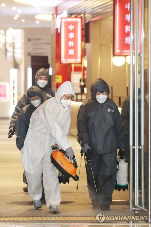 Workers disinfect a shopping mall in Seoul on Feb. 10, 2020, amid fears over the spreading new coronavirus. (Yonhap)