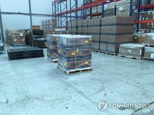 In this undated file photo, boxes of South Korea-made coronavirus testing kits are stored near Incheon International Airport before being shipped to the United Arab Emirates. It was provided by the Ministry of Foreign Affairs.(PHOTO NOT FOR SALE) (Yonhap)