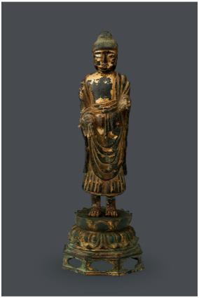 This photo provided by K Auction shows Gilt-bronze Standing Buddha. (PHOTO NOT FOR SALE) (Yonhap)