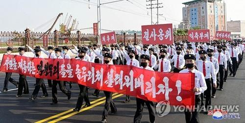 This photo, captured from the homepage of the Korean Central News Agency on June 9, 2020, shows one of the marches by North Korean youths and students across the nation in protest against anti-Pyongyang leaflets recently sent to the communist nation via balloons by North Korean defectors in South Korea. (For Use Only in the Republic of Korea. No Redistribution) (Yonhap)