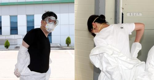 Medical workers take off protective clothing at Cheongju's Sangdang Community Health Center on June 10, 2020. (Yonhap)