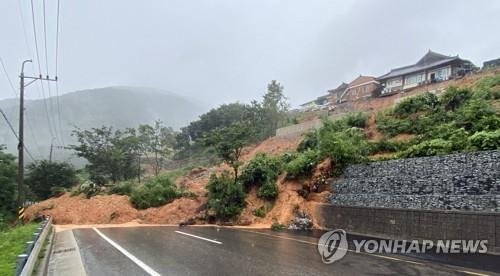 A road in Sancheong, South Gyeongsang Province, is closed to traffic on July 13, 2020, after being hit by a landslide caused by heavy rain, in this photo provided by the provincial government. (PHOTO NOT FOR SALE) (Yonhap)
