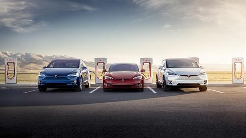This undated file photo, provided by Tesla, shows the Model X, Model S and Model X being charged by superchargers. (PHOTO NOT FOR SALE) (Yonhap)