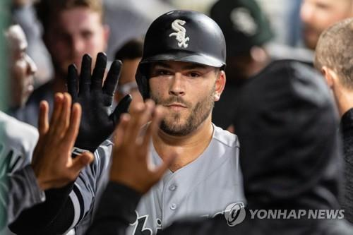 In this Getty Images file photo from Sept. 18, 2018, Daniel Palka of the Chicago White Sox is greeted by his teammates after hitting a solo home run against the Cleveland Indians in the top of the sixth inning of a Major League Baseball regular season game at Progressive Field in Cleveland. (Yonhap)