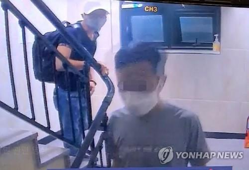 This photo provided by the Gyeonggi Southern Provincial Police Agency shows two of three Vietnamese nationals who escaped from a coronavirus quarantine facility in Gimpo on July 27, 2020. (PHOTO NOT FOR SALE) (Yonhap)