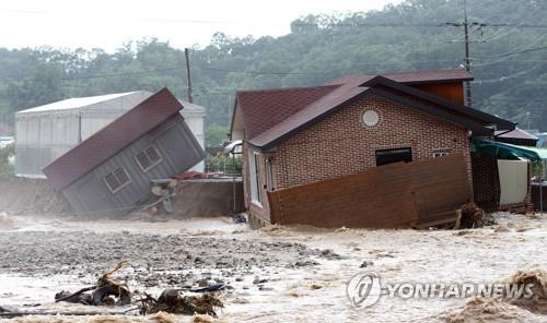 A house in Chungju, North Chungcheong Province, is destroyed by heavy rains on Aug. 2, 2020. (Yonhap)