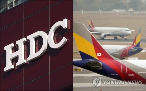 This file photo shows HDC's company logo and Asiana Airlines' planes at a local airport. (Yonhap)