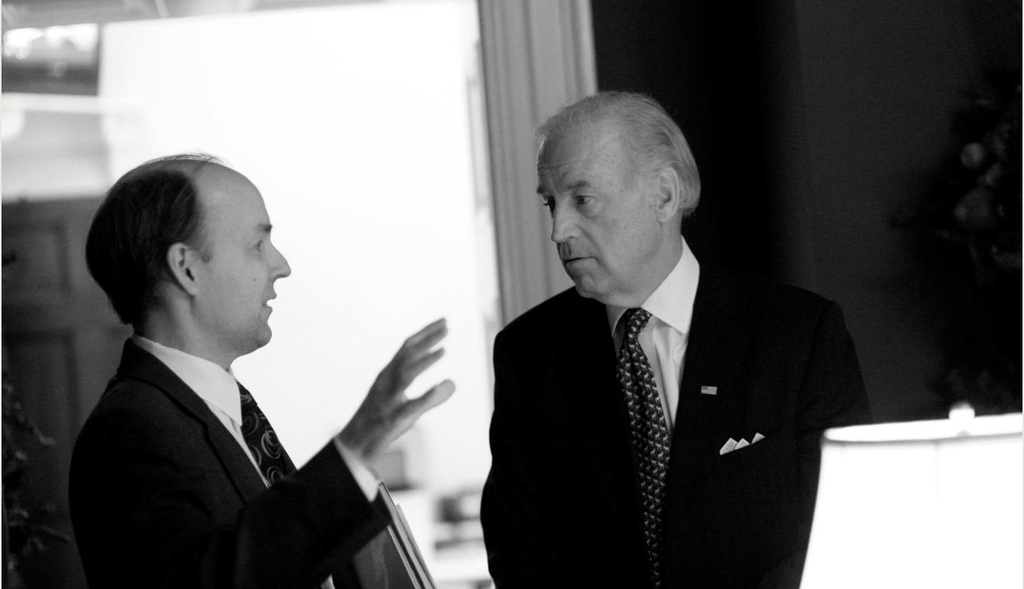 Joe Biden (R), the U.S. Democratic presidential nominee, and his long-time foreign policy adviser Brian McKeon are seen talking with each other in this undated photo provided by Biden's election campaign. (Yonhap)