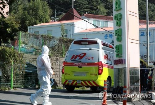 This photo shows a disinfection worker at a nursing hospital in the southern port city of Busan on Oct. 14, 2020. (Yonhap)