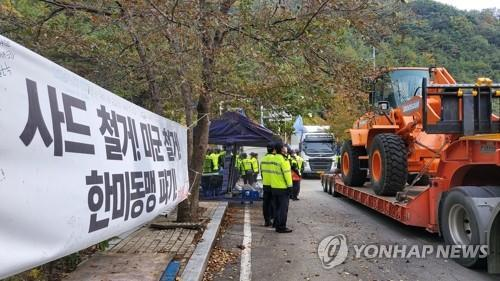 Trucks carrying construction equipment and materials enter a THAAD base in Seongju, central South Korea, on Oct. 22, 2020. (Yonhap)