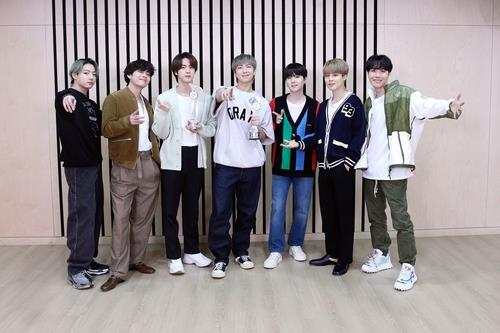 This photo from the International Federation of Phonographic Industry's (IFPI) official website shows K-pop superstar BTS holding an award it received from IFPI. (PHOTO NOT FOR SALE) (Yonhap)
