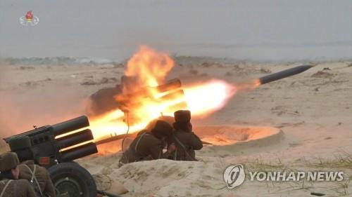 This image captured from a documentary film aired by North Korea's official Korean Central TV on Jan. 10, 2020, shows test-firings of multiple rocket launchers by an all-female military unit on the western border island of Changrin in November 2019. North Korean leader Kim Jong-un oversaw the firing drills. (For Use Only in the Republic of Korea. No Redistribution) (Yonhap)