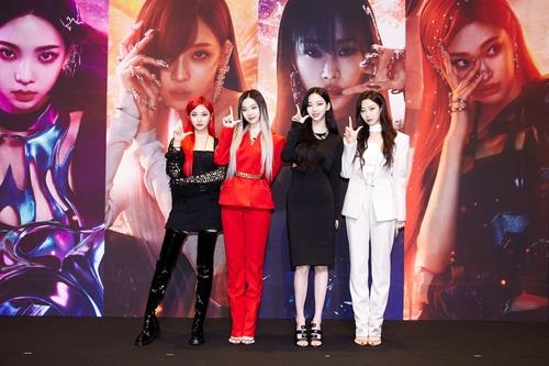 This photo, provided by SM Entertainment, shows K-pop act aespa posing during an online news conference on May 17, 2021. (PHOTO NOT FOR SALE)(Yonhap)