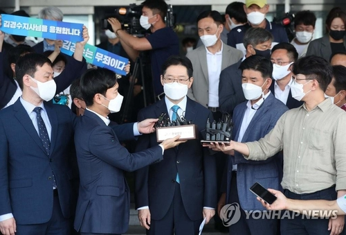 South Gyeongsang Province Gov. Kim Kyoung-soo answers questions from reporters outside his office in Changwon, South Korea, on July 21, 2021. (Yonhap)