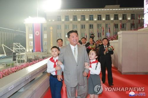 North Korean leader Kim Jong-un (C), accompanied by children, takes part in a military parade at Kim Il-sung Square in Pyongyang on Sept. 9, 2021, to celebrate the 73rd anniversary of the country's founding, in this photo released by the North's official Korean Central News Agency. (For Use Only in the Republic of Korea. No Redistribution) (Yonhap)