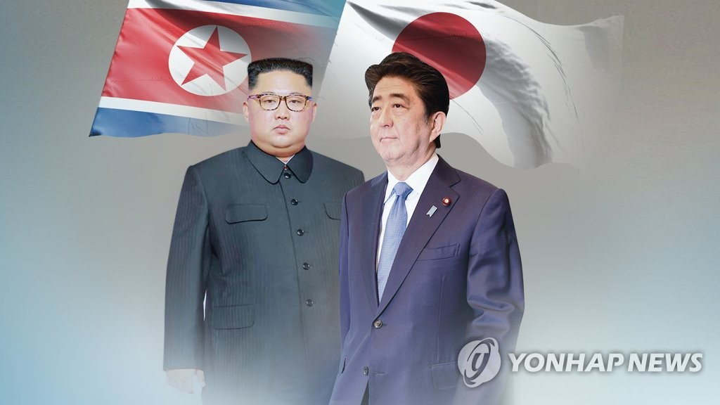 This image, provided by Yonhap News TV, shows North Korean leader Kim Jong-un (L) and Japanese Prime Minister Shinzo Abe. (Yonhap)