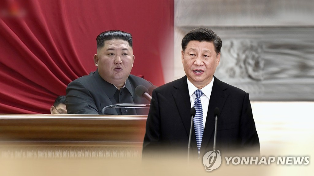 This image, provided by Yonhap News TV, shows North Korean leader Kim Jong-un (L) and Chinese President Xi Jinping. (Yonhap)
