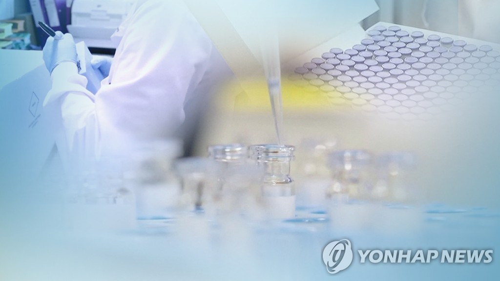 This image from Yonhap News TV shows researchers testing COVID-19 vaccines. (PHOTO NOT FOR SALE) (Yonhap)