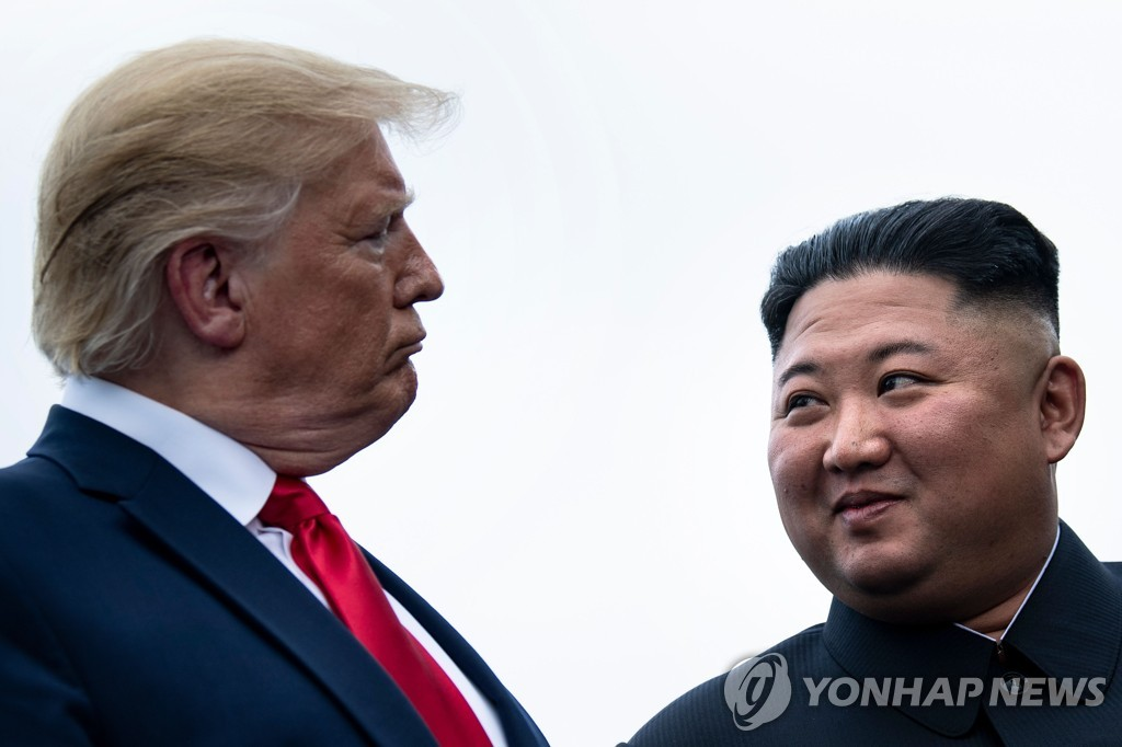 This AFP photo shows U.S. President Donald Trump (L) and North Korean leader Kim Jong-un before a meeting in the Demilitarized Zone on the inter-Korean border on June 30, 2019. (Yonhap)