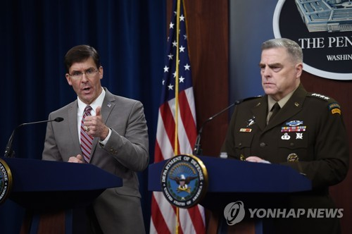 This AFP photo shows U.S. Secretary of Defense Mark Esper (L) and Army Gen. Mark Milley, chairman of the Joint Chiefs of Staff, holding a press conference in the briefing room at the Pentagon in Washington on March 2, 2020. (Yonhap)