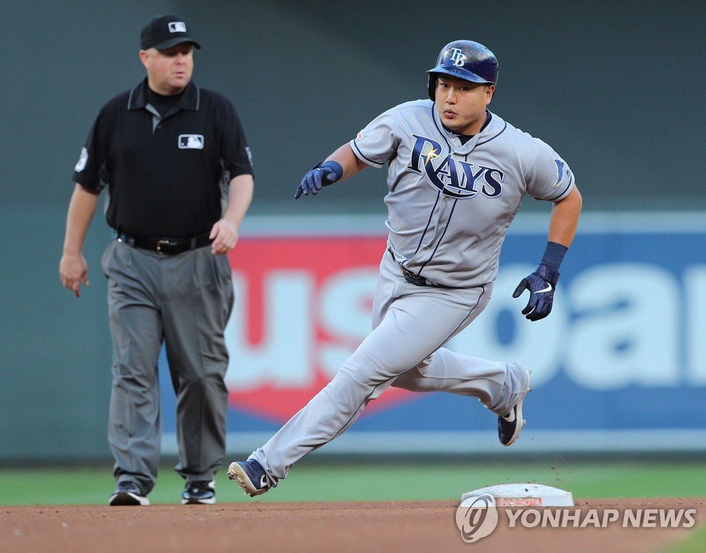 In this Getty Images file photo from June 26, 2019, Choi Ji-man of the Tampa Bay Rays rounds the second base in the top of the fourth inning of a Major League Baseball regular season game against the Minnesota Twins at Target Field in Minneapolis. (Yonhap)
